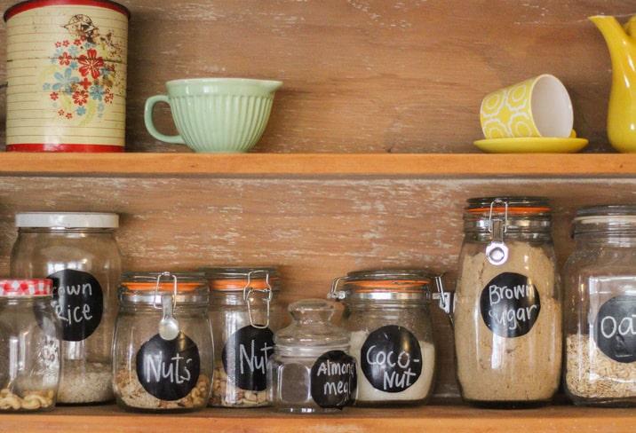 pantry storage shelf with labeled organization jars