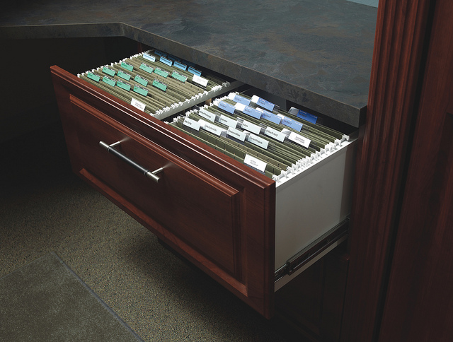 Wood drawer file cabinet.