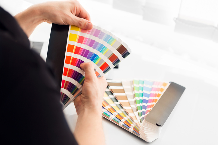 Designer choosing a color from color wheel