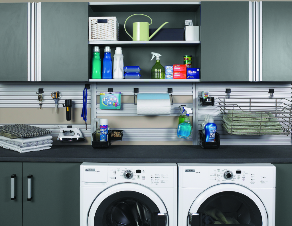 A laundry room organized with the help of cabinets from More Space Place
