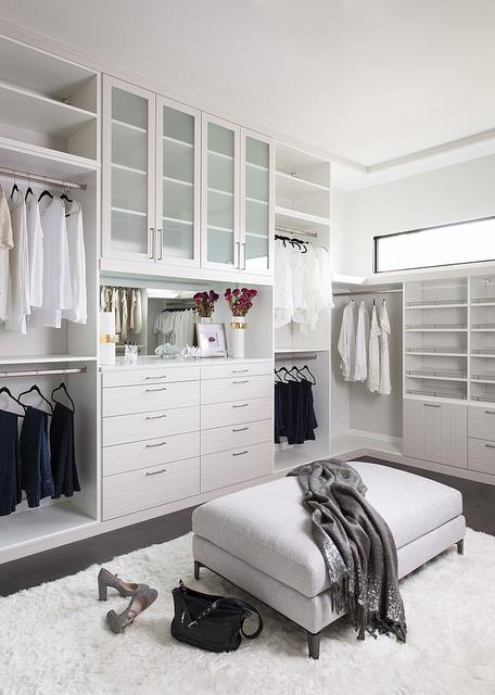 Organized white chocolate custom closet system