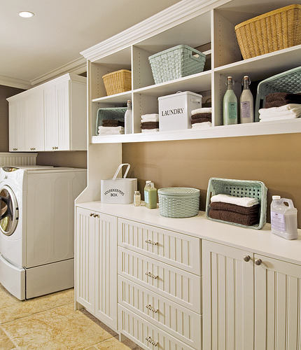 A laundry room organized with the help of baskets from More Space Place