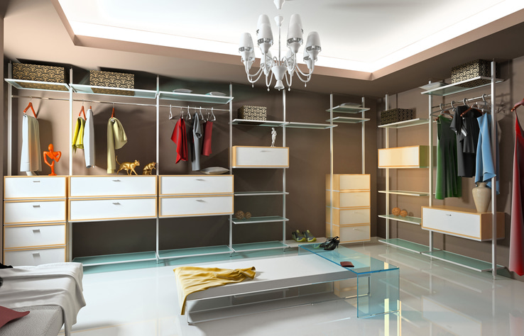 A custom closet with sliding shelves and soft-close drawers, courtesy of More Space Place