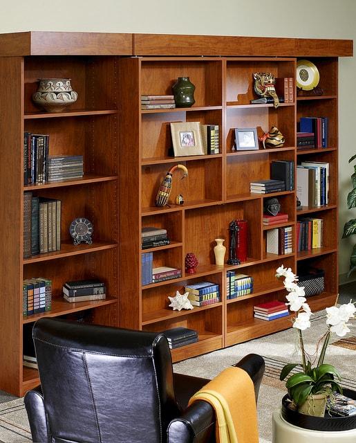 A brown bookshelf Murphy wall bed