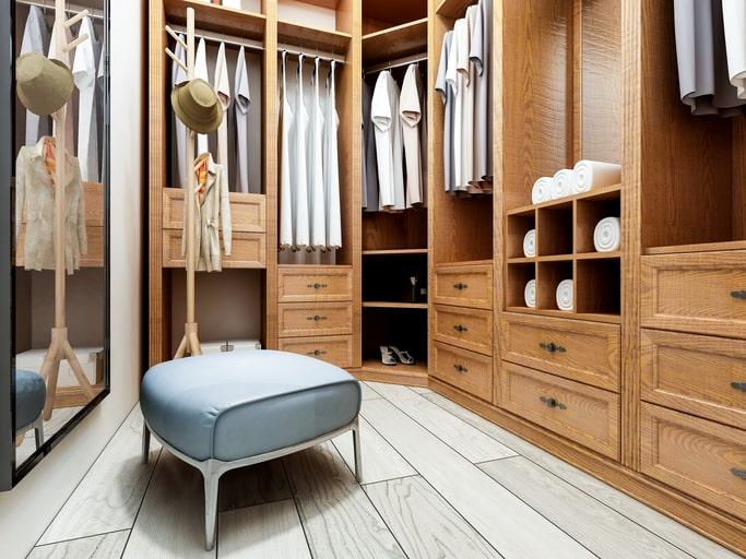 custom luxury closet with bench